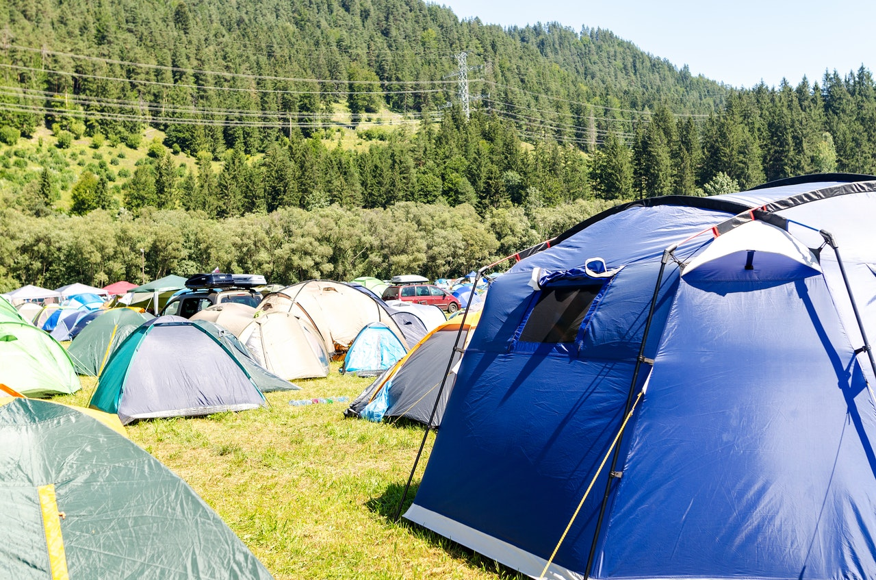 a cramped campsite full of tents